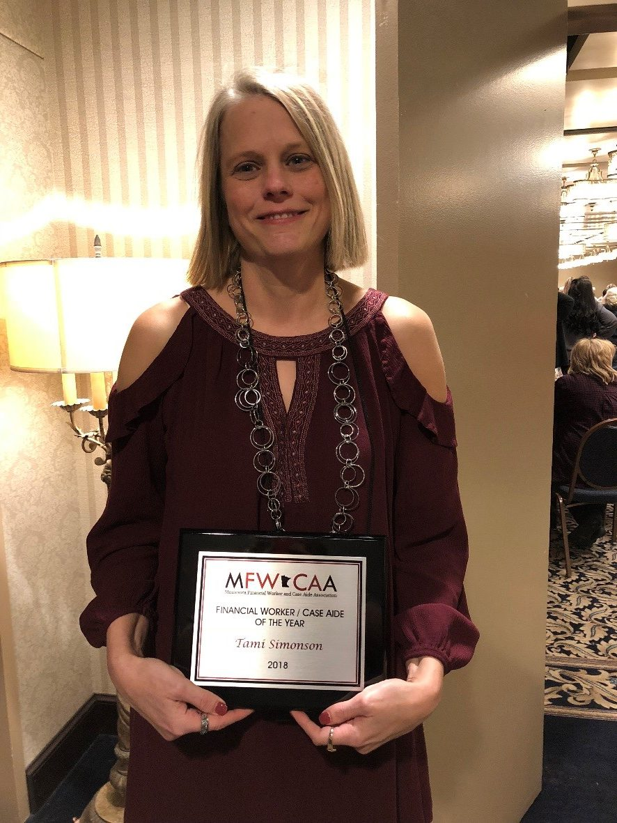 Tami Simonson holding her MFWCAA Financial Worker/Case Aide of the Year Award